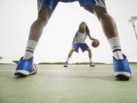 Basketball teams playing on court - BLEF13791