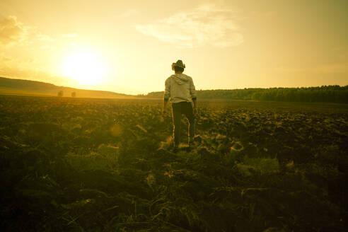 Mari man standing in rural field - BLEF13821