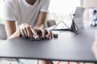 Close-up of woman working on computer equipment in office - UUF18534