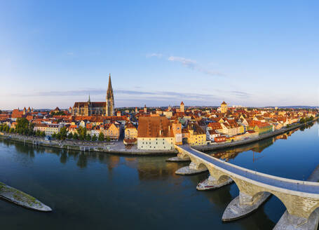 Aerial view of Stone Bridge over Danube River against sky at Regensburg, Bavaria, Germany - SIEF08856