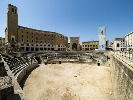 Roman amphitheater against clear blue sky in Altstadt during sunny day, Lecce, Italy - AMF07257
