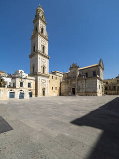 Exterior of Lecce Cathedral against clear blue sky during sunny day, Italy - AMF07260