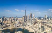 Aerial view of Dubai creek and Burj Khalifa Tower in background, UAE - AAEF01073