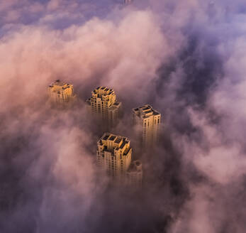 Aerial view of skyscrapers in the clouds of Dubai, U.A.E - AAEF01103