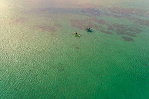 Aerial view of two men in traditional outrigger boats, Dauis, Philippines. - AAEF01160