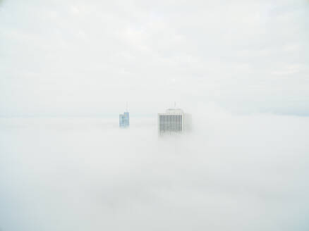 Aerial view of single tall skyscraper over the clouds, Chicago, USA - AAEF01277