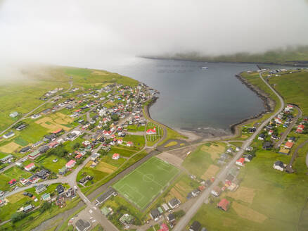 Aerial view of small city on the shore of north Atlantic sea, Faroe island - AAEF01325