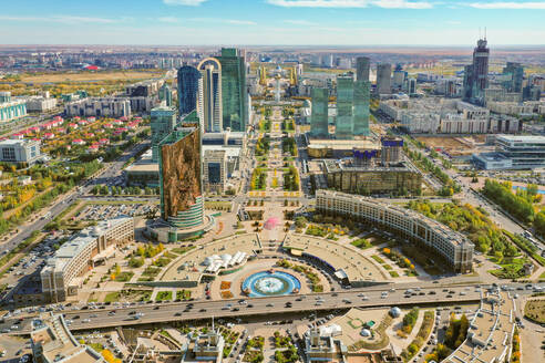 Aerial view of the Entertainment Centre, Nur Sultan, Kazakhstan. Taken in autumn as the leaves turn to a golden colour. With views towards the Bayterek tower. - AAEF01361