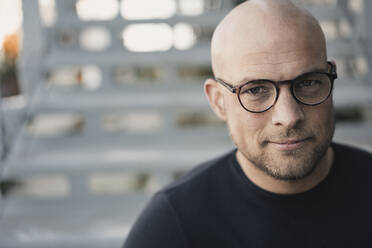 Portrait of bald man with beard wearing glasses - KNSF06212