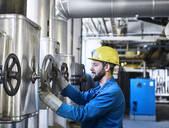 Technician turning a valve - CVF01449
