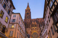 Low angle view of buildings and Notre Dame de Strasbourg against clear sky at sunset, France - JUNF01725
