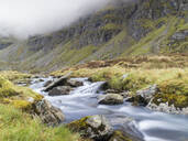 Scenic view of river against mountain, Scotland, UK - HUSF00072