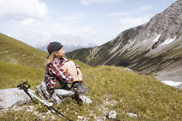 Girl having a break during a hike in the mountains - FKF03541