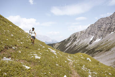 Boy hiking in the mountains - FKF03547