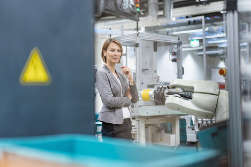 Portrait of a confident businesswoman in a modern factory - DIGF07837