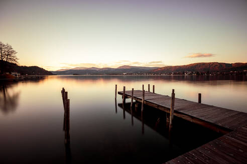 Scenic view of Woerthersee lake against sky during sunset, Austria - DAWF00953