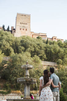 Back view of couple looking at Alhambra, Granada, Spain - LJF00663