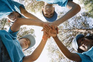 Group of kids stacking hands - JCMF00123