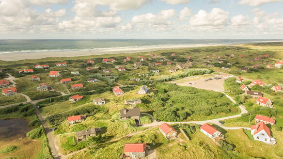 Aerial view of small houses on the coast in the Netherlands - AAEF01701