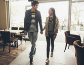 Couple holding hands in cafe - BLEF14033