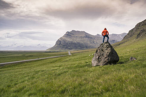 Man standing on rock in gthe Southern Region, Iceland - UUF18723