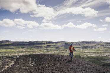 Mature man hiking in Vesturland, Iceland - UUF18816