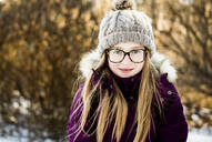 Caucasian girl smiling outdoors in winter - BLEF14368