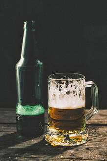 Glass and bottle of beer on table - BLEF14422