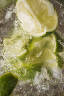 Close up of lime in iced drink - BLEF14437