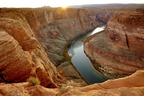 River winding through majestic rock formations in desert landscape, Page, Arizona, United States - BLEF14482