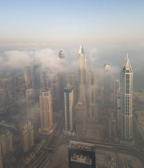 Aerial view of skyscrapers touching the clouds in Dubai, United Arab Emirates. - AAEF01756