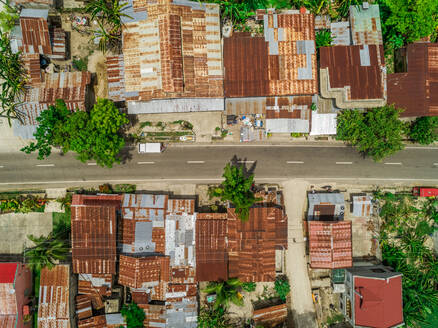 Aerial view of metal rooftops and road in Argao, Philippines. - AAEF01786