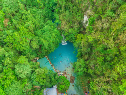 Aerial view of people swimming in pool by Kawasan Falls in Alegria, Philippines. - AAEF01807