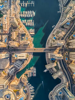 Aerial view of Dubai Marina with moored boats and skyscrapers, UAE. - AAEF01894
