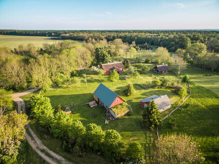 Aerial view of few houses in countryside of Estonia - AAEF01994