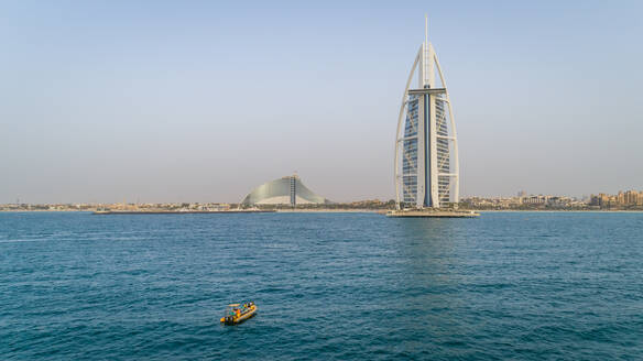 Aerial view of the luxurious Burj Al Arab Hotel and yellow boat, Dubai - AAEF02369