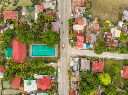 Aerial view of residential district with tennis court in Dauis, Philippines - AAEF02399
