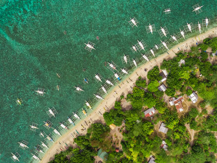 Aerial view of beach, buildings, filipino boats, Balicasag Island, Philippines. - AAEF02405