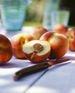 Fresh Peaches outdoors on garden table - PPXF00230