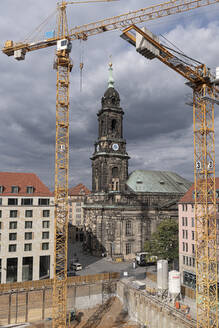High angle view of cranes and Kreuzkirche against cloudy sky in city, Saxony, Germany - CHPF00545
