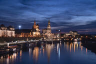 Elbe river by Hofkirche und Semperoper against sky in city at night, Saxony, Germany - CHPF00563