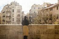 Woman looking at Placa dels Furs, Fueros Museum from Torres de Serranos, Valencia, Spain - TAMF02131