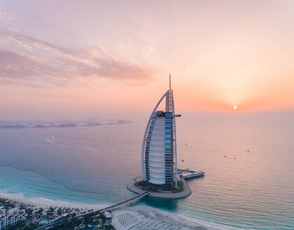 Aerial view of the luxurious Burj Al Arab Hotel at sunset in Dubai, UAE - AAEF02712