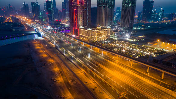 Aerial view of illuminated skyscrapers in downtown Dubai at night, UAE - AAEF02778