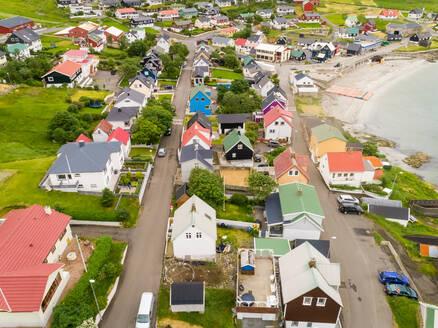 Aerial view of neighborhood with colorful rooftops, Faroe island - AAEF02964