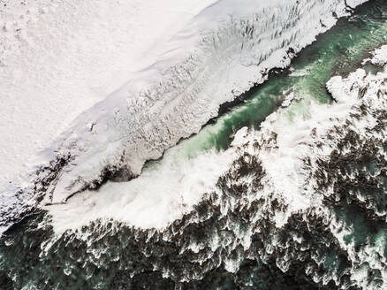 Abstract aerial view of the Ölfusá river in winter in Iceland - AAEF03081
