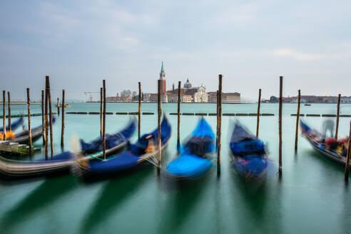 Gondolas moored in Piazza San Marco with San Giorgio Maggiore church in the background, Venice, UNESCO World Heritage Site, Veneto, Italy, Europe - RHPLF00642