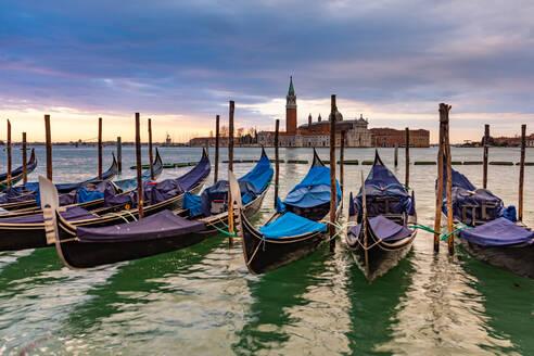 Gondolas moored in Piazza San Marco with San Giorgio Maggiore church in the background, Venice, UNESCO World Heritage Site, Veneto, Italy, Europe - RHPLF00648