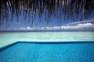 Infinity pool and lagoon, Maldives, Indian Ocean, Asia - RHPLF00902