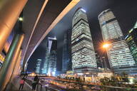 Wide angle view of ultra modern architecture in Shanghai Pudong at night, Shanghai, China, Asia - RHPLF00962